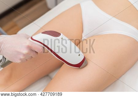 Close-up Of Laser Hair Removal On The Leg. The Doctor Removes Unwanted Hair From The Patient With An
