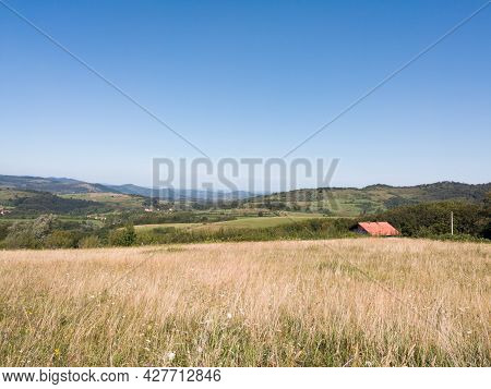 Hilly Landscape With Scattered Houses On Manjaca Mountain Near Banja Luka