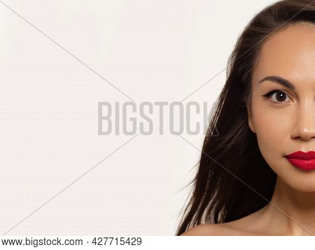 Half Beauty Closeup Of Women Full Red Lips With Shiny Skin And Long Hair. Facial Skin Care In A Spa