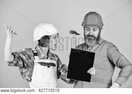 Renovation Concept. Couple Planning Changes Renovation Apartment. Couple Looking At Documents. Famil
