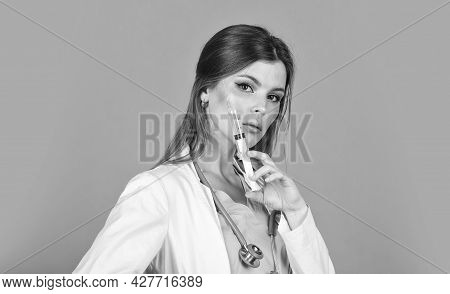 Medical Procedures. Adorable Woman Making Injections. Vaccination And Treatment. Beauty Injections.