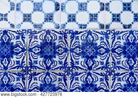 Porto, Portugal - December 01, 2019: Blue Tin Glazed Tiles In One Of The House Facade In The Old Tow