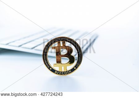 Bitcoin Icon. Gold Crypto Currency Btc Bitcoin With Keyboard On White Background. Golden Bit Coin Vi