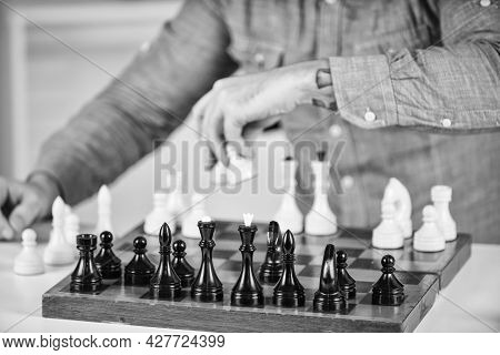 Competition Success Play. Concentrated Man Developing Chess Strategy. Playing Board Game With Friend