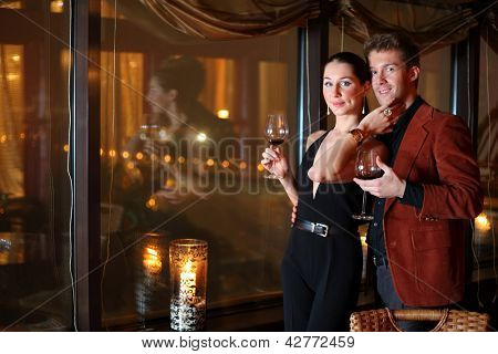 woman and a man with a glass of wine at the restaurant