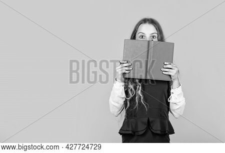 Hooked On Book. Small Child Cover Face With Book. Little Girl Read Book Yellow Background. Cute Book