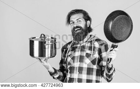 Man Holding Frying Pan.. Male Chef Kitchener Cooking. Hipster Shirt For Bearded Guy Cook. Unshaven B