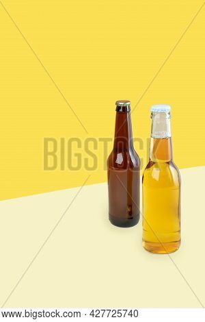 A Bottles Of Craft Lager And Porter Beer On Dual Color Yellow Background. International Beer Day Or