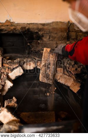 Old Cooking Stove, Brick In Soot, Stove In The Form Of An Arch, Dismantling Of The Stove.