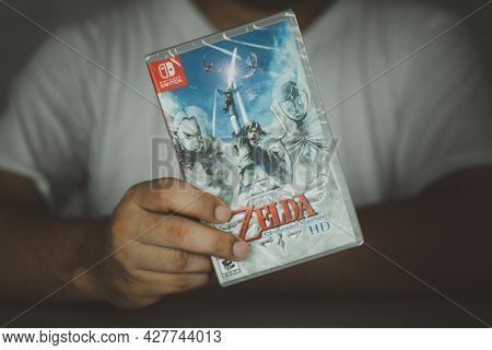 Samut Prakan, Thailand - July 24, 2021 : A Man Holding Nintendo Switch Gaming Box Of The Legend Of Z