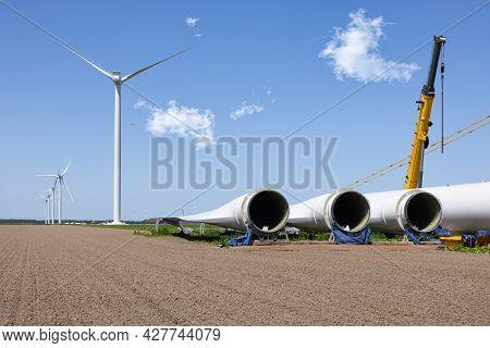 Dutch Construction Site New Wind Turbine Farm In Zeewolde With Wings Ready To Install