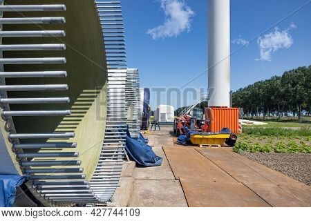 Dutch Construction Site New Wind Turbine Farm In Zeewolde With Wings And Bolts Ready To Install