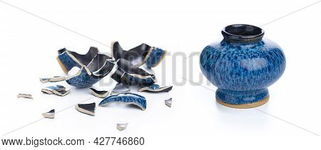 Ceramic Vase And Its Broken Form On Isolated White Background