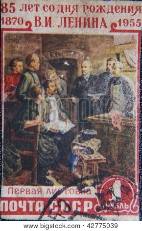 RUSSIA - CIRCA 1952: stamp printed by USSR in 1955 shows  Lenin reading first flyer with coworkers