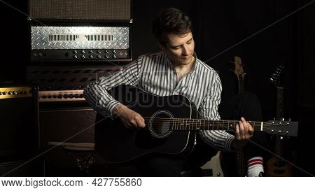 Handsome Young Acoustic Guitar Blues Player Performing His Musical Skills. Hipster Guitar Player Str