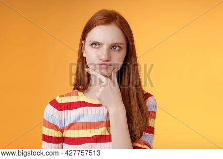 Perplexed Hesitant Serious-looking Ginger Girl Blue Eyes Weihing Choices Pouting Touch Chin Look Upp