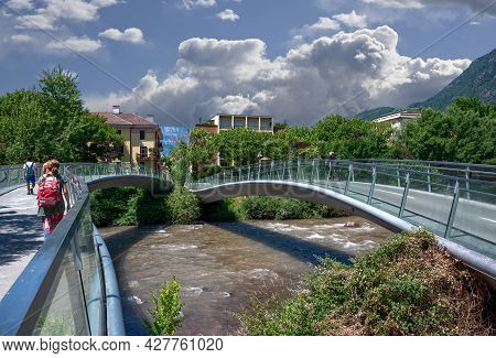 Bolzano, Italy, June 2021. The Pedestrian Bridge That Crosses The River Recalls The Structure Of The