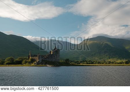 Castle Ruins On A Lake. Kilchurn Castle On Loch Awe In Summer In The Scottish Highlands