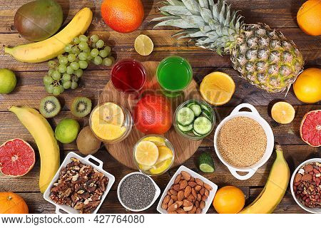 Assorted Fresh Summer Tropical Fruits, Vegetables And Nuts On Bright Sunny Table, Citrus Mix, Detox