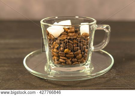 Preparation For Brewing Coffee In A Glass Cup.\\na Glass Cup Standing On A Saucer Made Of Transparen