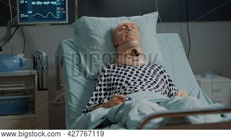 Patient With Cervical Collar For Neck Laying In Hospital Ward Bed With Nasal Oxygen Tube And Oximete