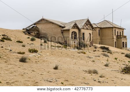 Houses reclaimed by the desert at Kolmanskop, Namibia