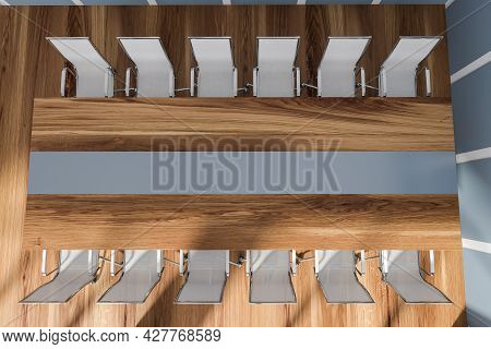 Office Interior With The Top Of Wooden Meeting Table With Blue Stripe In The Middle And Twelve Metal