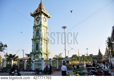 Ancient Building Clock Tower In Mahamuni Paya Pagoda Temple For Burmese People And Foreign Traveler