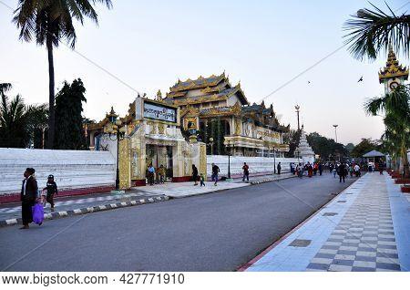 Burmese People And Foreign Travelers Walking On Street Go To Mahamuni Paya Pagoda Temple For Travel