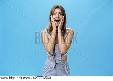Charismatic Surprised Good-looking Adult European Female With Cute Gap Teeth Smiling Broadly Pressin