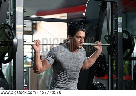 Handsome Adult Caucasian Men Sweating While Lift Up The Barbell Workout Machine For Muscle Part Insi