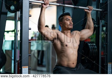 Handsome Shirtless Adult Asian Men Sweating While Lift Up The Barbell Workout Machine For Muscle Par