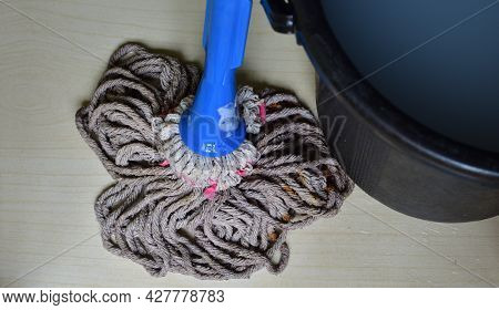 Wipe Floor With A Mop - Mopping The Floor With Disinfectant Liquid And Water.