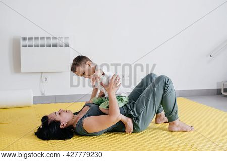 Mother Playing With Cute Disabled Child. Talking And Communicating With Cerebral Palsy Boy On The Fl