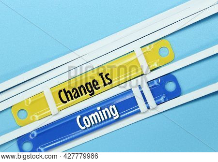 Colored Paper Clamps With The Words Change Is Coming