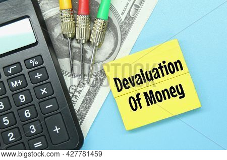 Calculator, Arrows, Paper Money With The Word Devaluation Of Money