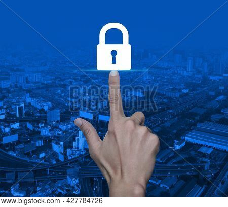 Hand Pressing Padlock Flat Icon Over Modern City Tower, Street, Expressway And Skyscraper, Technolog