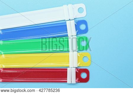 Paper Fastener With A Light Blue Background