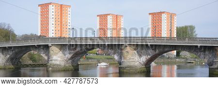 High Rise Orange Council Flats In Dumbarton Next To River Leven