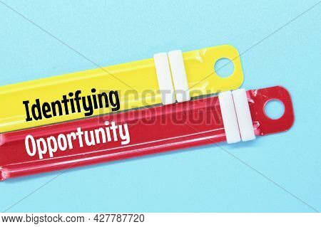Paper Binder With The Word Identifying Opportunity