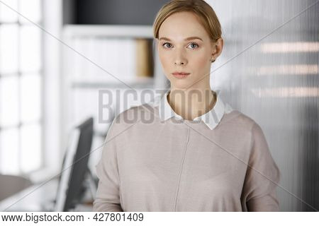 Friendly Adult Casual Dressed Business Woman Standing Straight. Business Headshot Or Portrait In Off