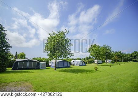 Camping Site With A Tent Camp On A Large Green Lawn In The Summer