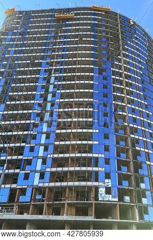 Facade Of Typical High Rise Apartment Building With Balcony And Windows. Contemporary Architecture.
