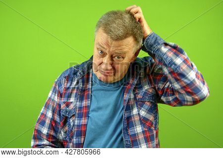 Confused Puzzled, Bewildered Senior Caucasian Man In Checkered Shirt Expression And Scratching His H