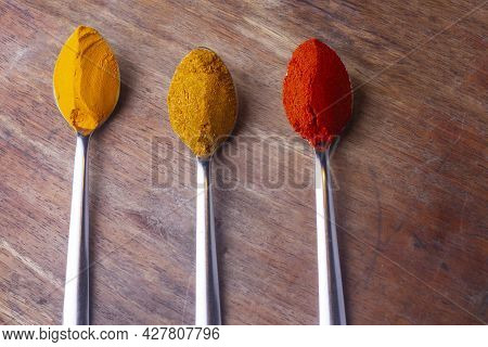 Indian Colourful Spices Also Know As Red Chilli Powder, Turmeric Powder, Coriander Powder, Mirchi, M