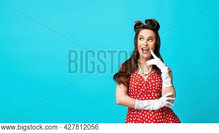 Portrait Of Millennial Pinup Woman In Retro Vintage Outfit Feeling Playful, Looking At Empty Space O