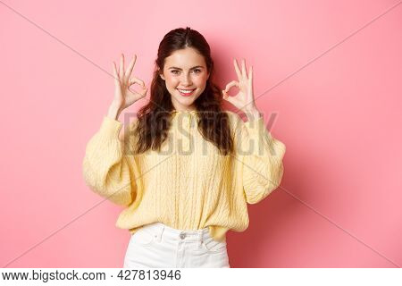 Young Confident Girl Showing Okay Signs And Smiling, Praise Something Perfect, Say Yes Or Alright Ge