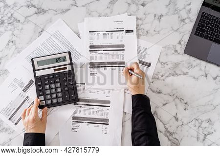 Cropped Shot Of Woman Calculating Important Monthly Expenses, Estimating Total Utility Payments, Usi