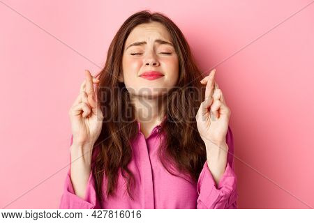 Close Up Of Hopeful Desperate Woman Begging God, Holding Hands In Pleading Gesture And Close Eyes, S