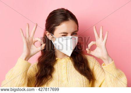 Preventive Measures, Health Care Concept. Close Up Of Confident Girl Says Okay, Winks And Nods, Assu